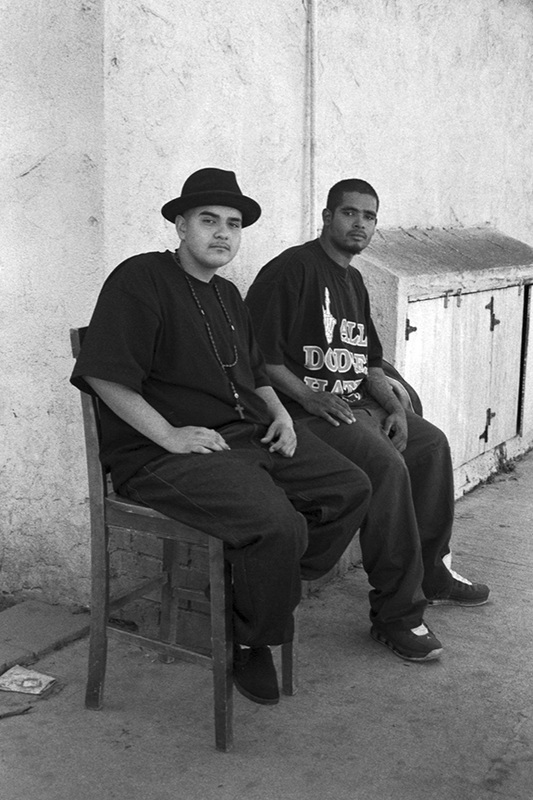 A picture from Ortiz's series 'A Portrait of my Neighborhood'. Pictured are two gentlemen from Ortiz's neighborhood, Long Beach.