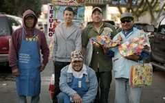 A photograph from Ortizs project Todos Somos Familia. Pictured are some of the vendors that did business in Tijuana, and Ortiz noted that many of them shared a familial bond.