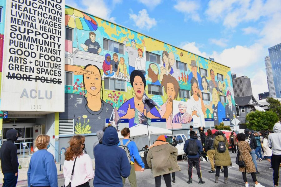 BLM protests to abolish police in front of ACLU mural on March 8, 2021. The mural features several BLM organizers and supporters.