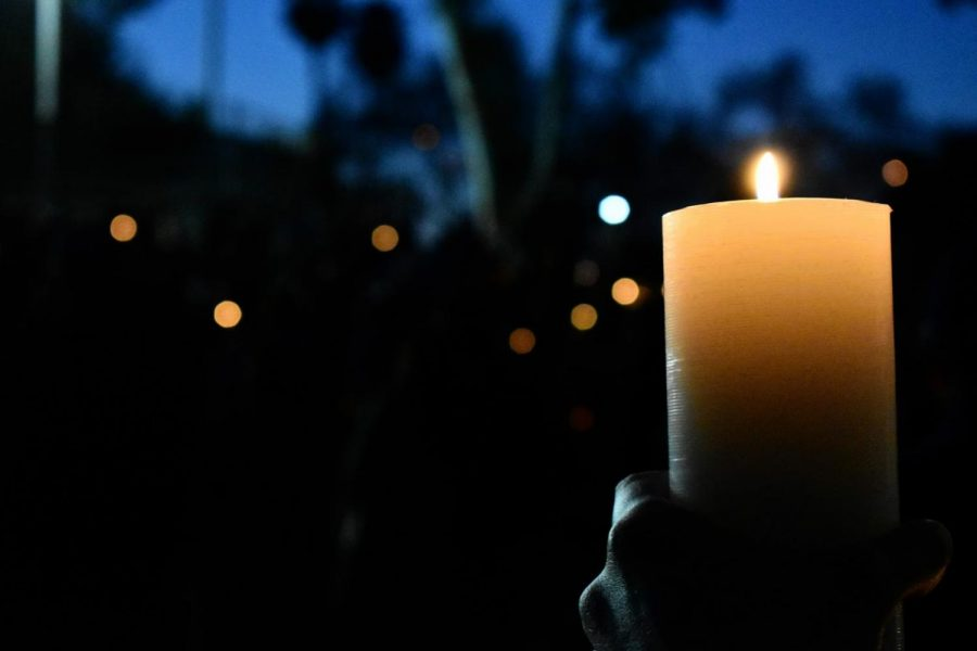 The candlelight vigil in Alhambra on March 20, 2021, is for the victims of Asian-hate crimes. Many supporters brought their own candles while others received them at the event.