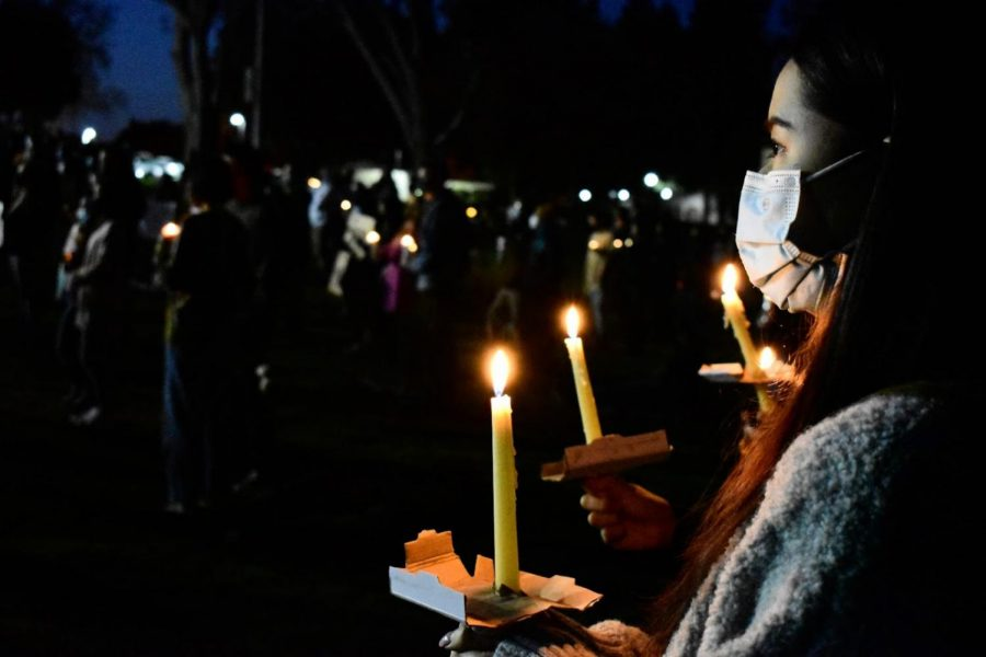 The Asian community came together to support the victims of Asian-hate crimes during a vigil in Alhambra on March 20, 2021. Many light candles during the vigil.