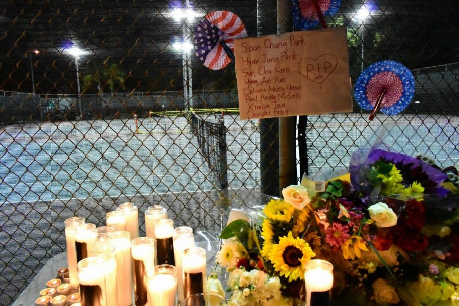 The victims of the Asian-targeted attack in Atlanta, GA are listed during a vigil in Alhambra on March 20, 2021. Supporters share condolences by leaving flowers and candles.