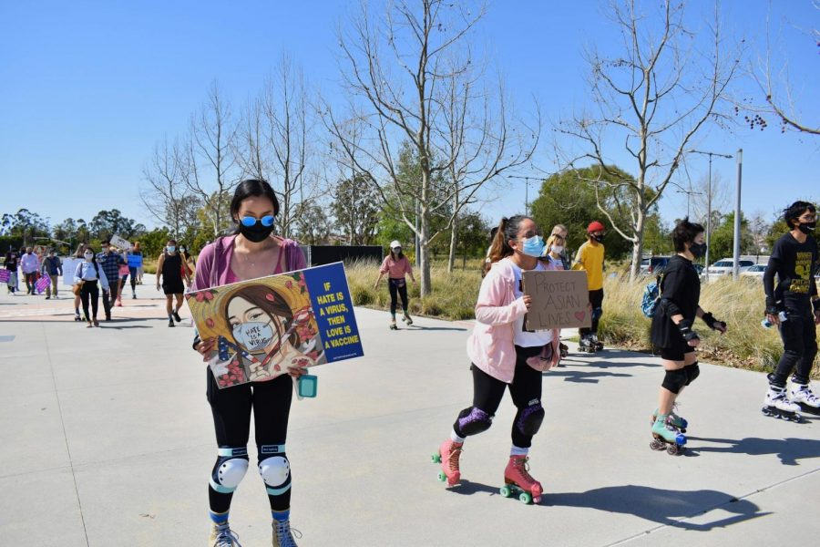 Supporters carried signs promoting peace and unity during a demonstration against  Anti-Asian Hate in OC Great Park on March 20, 2021. Signs had messages such as