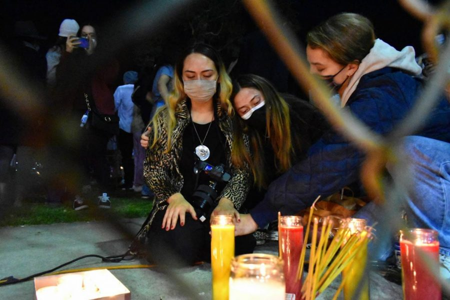 Young women pray during a vigil in Alhambra on Mach 20, 2021, for the victims of the Asian-targeted shooting in Atlanta, GA. Everyone in attendance is instructed to wear a mask.