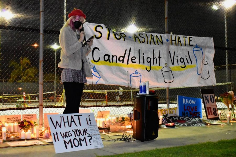 Kaila Karns shares a personal story during a vigil in Alhambra on March 20, 2021. She recalls being discriminated against during a photo-shoot.