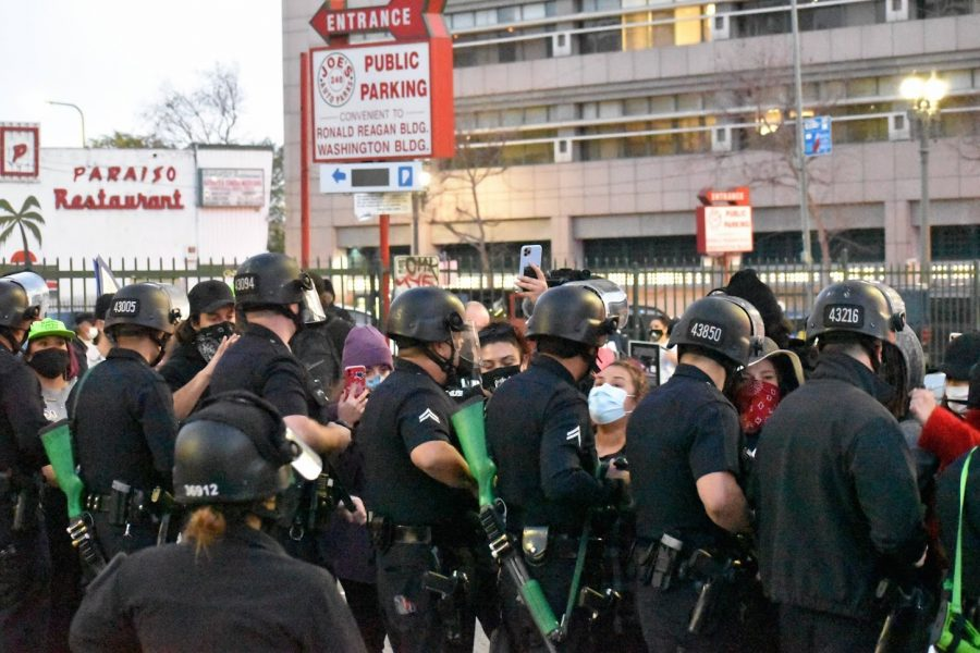 As the Womens Day march ends, LAPD blocks the protesters exit on March 8, 2021. Law enforcement formed a scrimmage line to block the street and closed gates to parking lots to trap demonstrators.