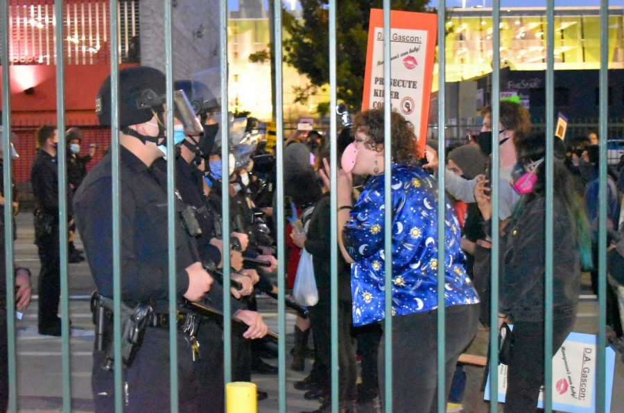 LAPD presence aggravates peaceful protesters during a Womens Day protest on March 8, 2021. Police formed a scrimmage line and closed parking lot gates to trap demonstrators on Spring Street.