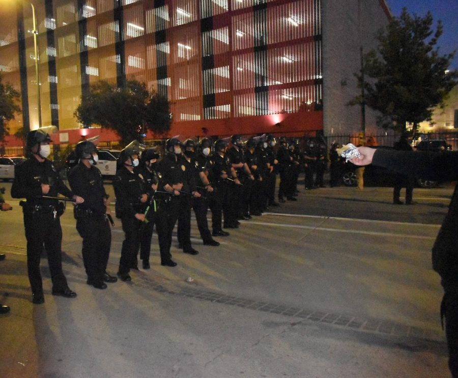 LAPD forms a scrimmage line on Spring Street to block the exit of peaceful protesters on March 8, 2021. They blocked all exits to trap the demonstrators.