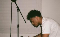 Cerritos artist, Calvin Jones, rehearses lyrics before getting ready to record a song. Jones plans to take 2021 by storm as he prepares to release new albums for his fans and the city. Photo credit: 10kfilmgallery