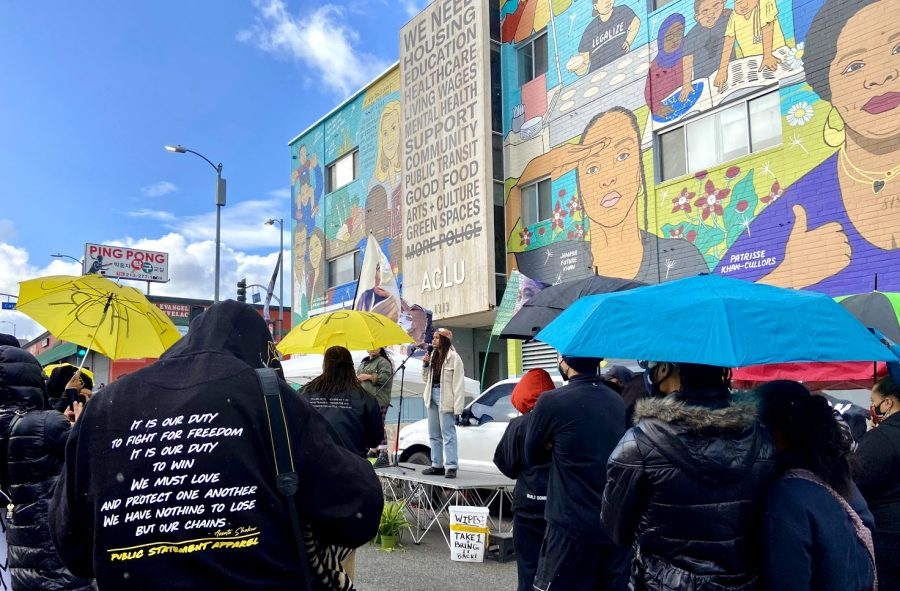 Despite the heavy rain, BLM supporters attended the protest to end police associations on March 8, 2021. Organizers provided umbrellas to protestors.