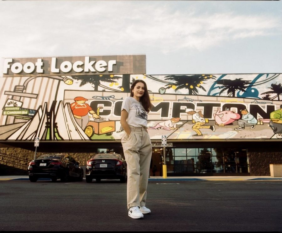 Young Compton artist in front of the mural she helped create for her local Footlocker. credit: https://www.instagram.com/meldepaz/ Photo credit: Melissa Depaz