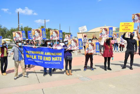 "Dozens attended the ""Skate to End Hate"" protest in Irvine on March 20, 2021. While most skated or rode bikes, some supporters marched and carried banners with messages of unity. Photo credit: Vincent Medina"