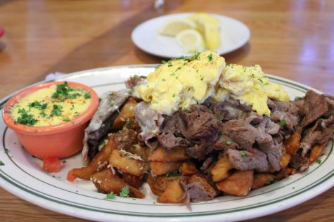 Waitress brings Lola the Quentin's Philly Hash with a side of hollandaise sauce on Feb 20. The aroma of the hot food fills all around.
