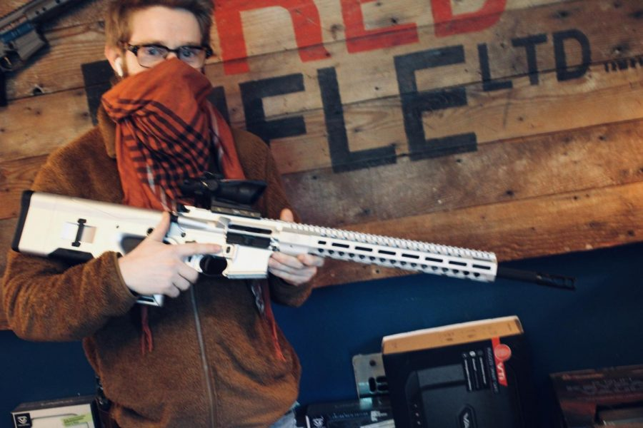 Jack+Brandhorst%2C+owner+of+Red+Rifle+arms+in+Carson%2C+posing+with+an+AR-15+on+March+24.+This+gun+is+ready+to+picked+up+buy+a+purchaser.+Photo+credit%3A+Lola+Ajetunmobi