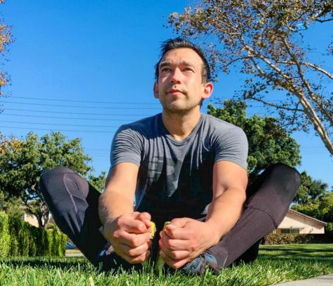 Rincon stretches before a run Nov 13., 2020 at Liberty Park in Lakewood, CA. Although he enjoys HIT-based workouts and weightlifting, he also runs regularly to stay in shape.