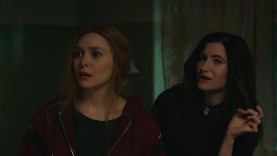 (L-R): Elizabeth Olsen as Wanda Maximoff and Kathryn Hahn as Agatha Harkness   in Marvel Studios' WANDAVISION, exclusively on Disney+. Photo Courtesy of Marvel Studios. @Marvel Studios 2021. All Rights Reserved. Photo credit: Walt Disney Company & Marvel Studios