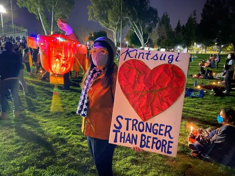 "Faculty member, Rebecca Pang holds and traditional lantern at a candlelight vigil in Alhambra on March 2021. Different communities came out to support, chanting ""Stop Asian Hate"" and ""Black Lives Matter""."