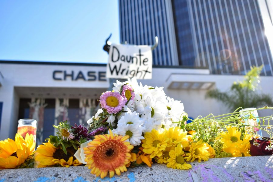 A memorial is displayed for Daunte Wright and Adam Toledo in West Hollywood on April 18, 2021. Demonstrators bring candles and flowers.