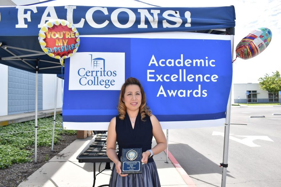 Linh Nguyen accepts her award for Academic Excellence on April 7, 2021. She receives the award for Cosmetology.
