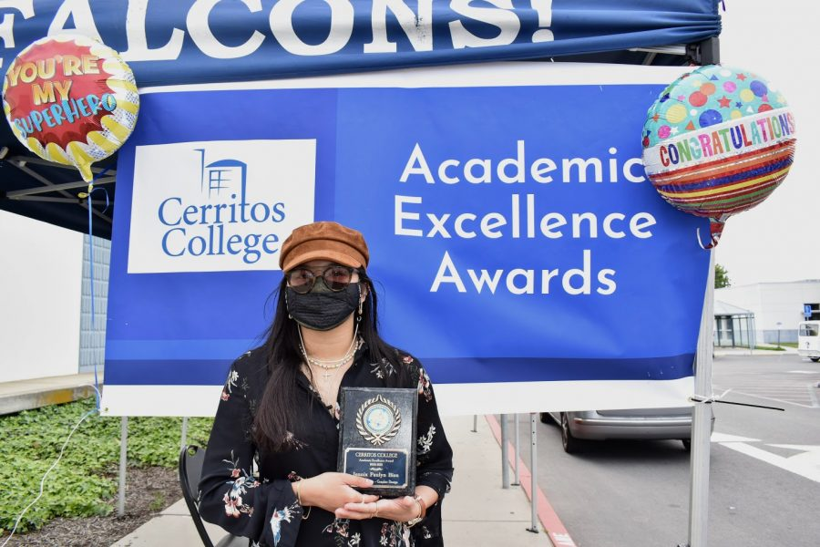 Jennix Paul Bien accepts her award for Academic Excellence on April 7, 2021. She received the award for Art and Design - Graphic Design.