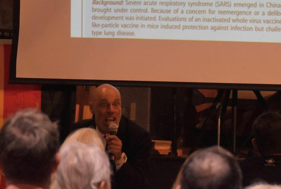 Dr. Billy Demoss touted debunked articles and counter-information about the COVID-19 virus during a seminar on March 31, 2021. The audience at the indoor seminar had no social distancing or masks.