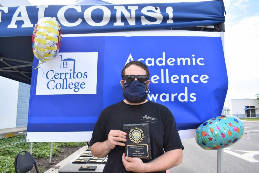 Gabriel Tidwell accepts his award for Academic Excellence on April 7, 2021. He received the award for WMT: Woodworking.