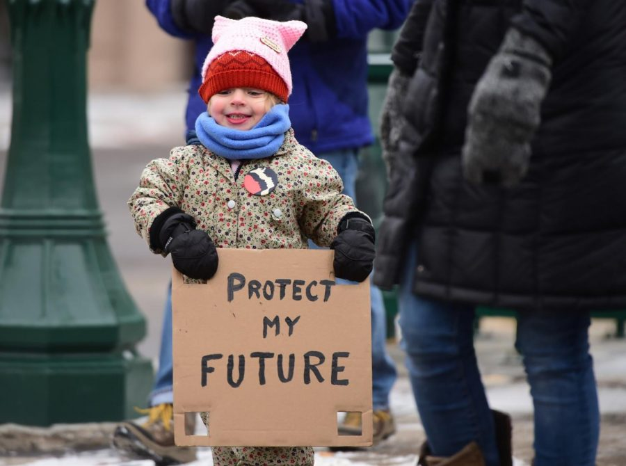 Ingrid Holweger, 3, of Syracuse during the Syracuse Women's March. About 150 people marched to the University United Methodist Church from the James M. Hanley Federal Building, Sat. Jan. 18, 2020, Syracuse, N.Y.