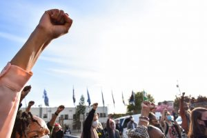 BLM supporters raise their fists in solidarity as the Wednesday-annual protest comes to an end. They held the demonstration in front of the LA PPL on April 14, 2021.
