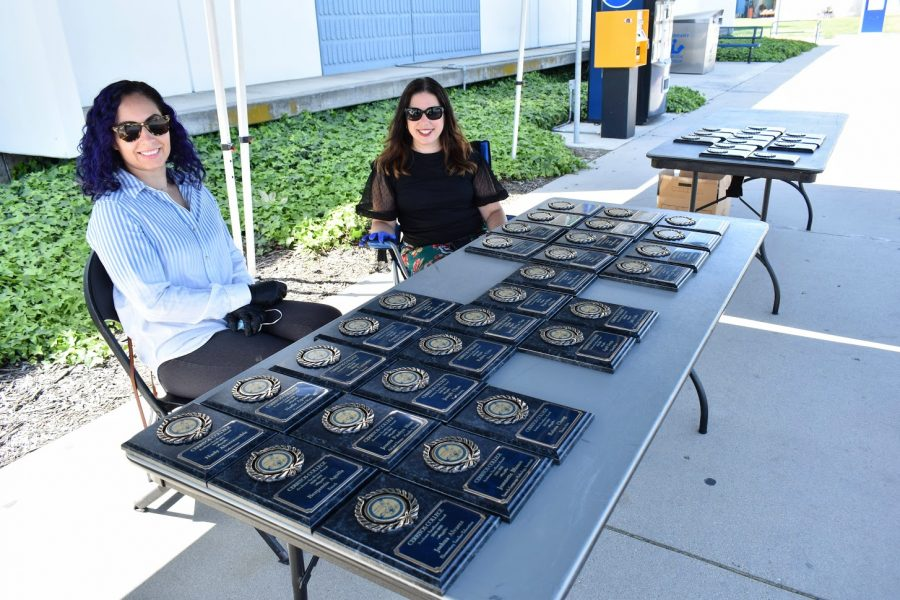 Professors Christine Gregory and Teresa Cheatham hand out Academic Excellence Awards on April 5, 2021. They give recipients their awards during a socially distanced drive-thru ceremony in the college parking lot.