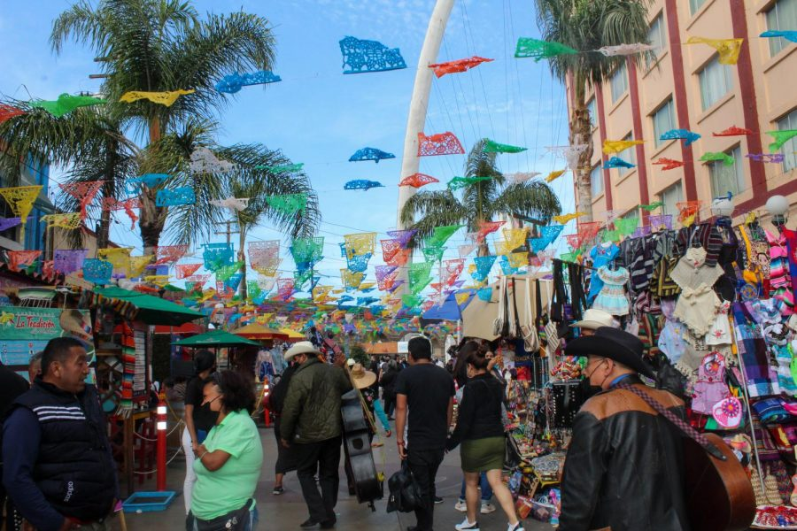 Locals, tourists, and mariachis all walk along Plaza Santa Cecilia on April 10, 2021. It is decorated with colorful