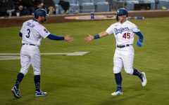 The Los Angeles Dodgers' Chris Taylor (3) and Matt Beaty (45) celebrate after they both scored on a two-run single by Corey Seager against the San Diego Padres in the sixth inning at Dodger Stadium on Saturday, April 24, 2021 in Los Angeles. Photo credit: Gina Ferazzi/Los Angeles Times/TNS