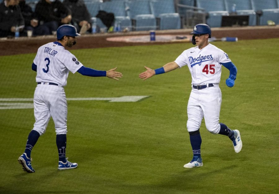 The+Los+Angeles+Dodgers%27+Chris+Taylor+%283%29+and+Matt+Beaty+%2845%29+celebrate+after+they+both+scored+on+a+two-run+single+by+Corey+Seager+against+the+San+Diego+Padres+in+the+sixth+inning+at+Dodger+Stadium+on+Saturday%2C+April+24%2C+2021+in+Los+Angeles.+Photo+credit%3A+Gina+Ferazzi%2FLos+Angeles+Times%2FTNS