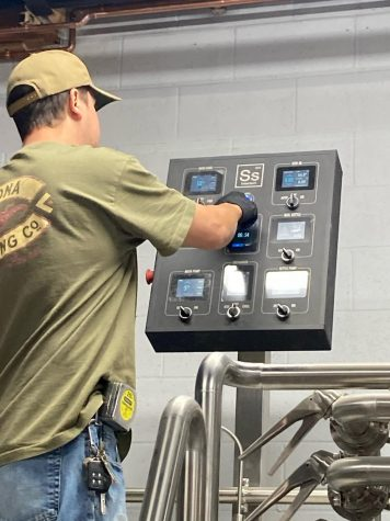 Derek Johnstone testing his new equipment. He began brewing 10 years ago in his home with friend and co-owner Jason Sullivan.