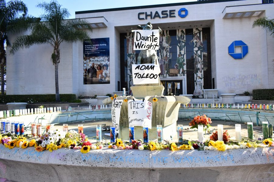 Activists+make+a+candlelight+vigil+for+Adam+Toledo+and+Daunte+Wright+in+West+Hollywood.+People+pass+by+and+paid+their+respects+on+April+18%2C+2021.+Photo+credit%3A+Vincent+Medina