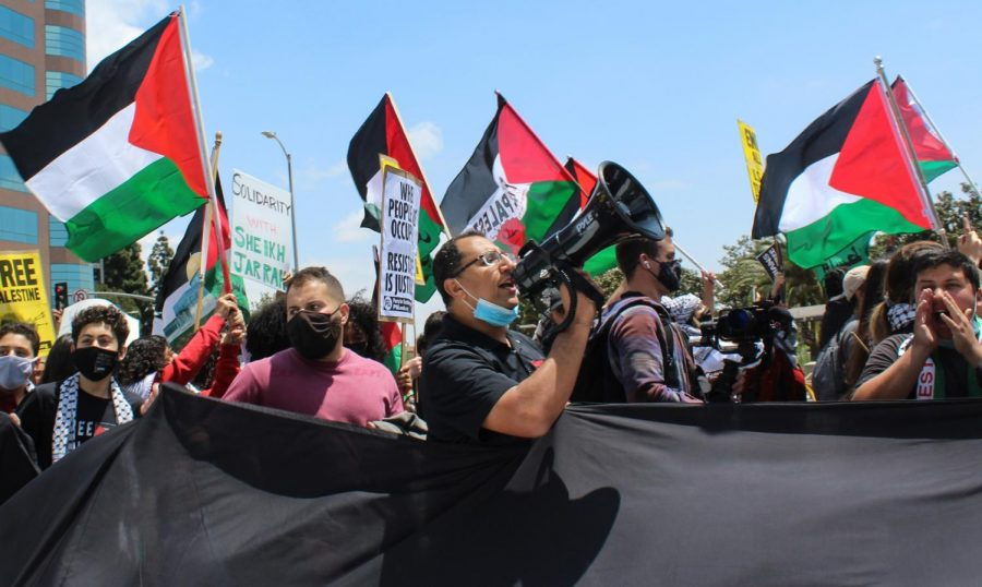 Protestors at the LA Palestinian Rally on May 15 passionately chanted as they marched along Wilshire Blvd. Thousands changed Free, free Palestine in unison while waving Palestinian flags.