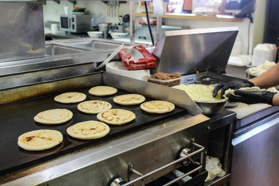 Miriam Sosa, Manager,  prepares masa for Pupusas at La Praviana on May 9. The restaurant sells about 3,000 pupusas per week.