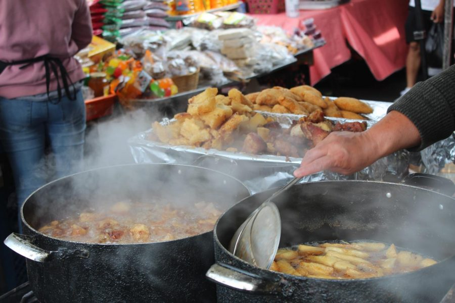On April 25, a street vendor at the El Salvador Community Corridor fries one of Central Americas most popular delicacies, yucca frita con chicharron. The fried cavassa root is similar to potato fries and is served with fried pork rinds.