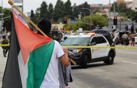 Heavy police presence loomed at a Palestinian Rally/Protest on May 15. Thousands of protestors showed up at the Wilshire Federal Building to protest the most recent violent attacks against Palestinians in the Middle East.
