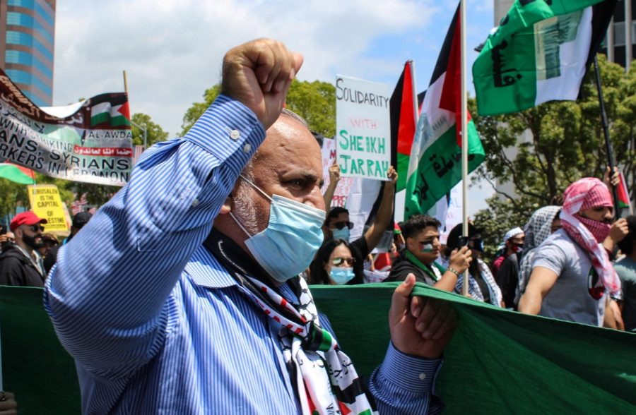 People of all ages and races marched on May 15 at a rally for Palestinians. The protest began at the Wilshire Federal Building and continued West on Wilshire Boulevard as they held and waved Palestinian flags.