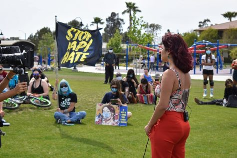 Jenna Dupuy gives an emotional speech during a protest against AAPI hate at the Tustin Legacy skate park on May 1, 2021. A camera crew films her for a documentary on AAPI hate crimes.