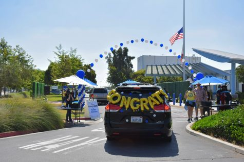 Graduates decorate their cars with balloons during a drive-thru commencement ceremony on May 28, 2021. Counselors admire their hard work and dedication.