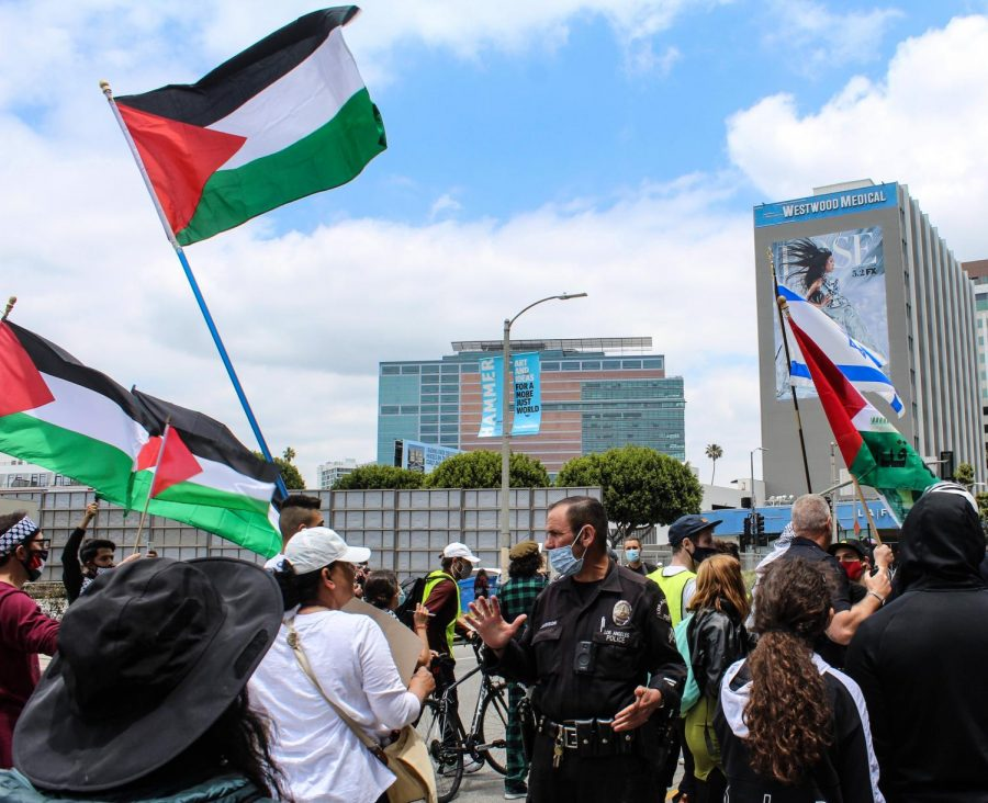 After increased tension between Palestinian supporters and Rabbi Daniel Bouskilas presence, police officer intervened to diffuse the situation. LAPD Senior Lead Office Jim Lavenson said the strong police presence was there to make sure no citizens got injured. May 15, 2021