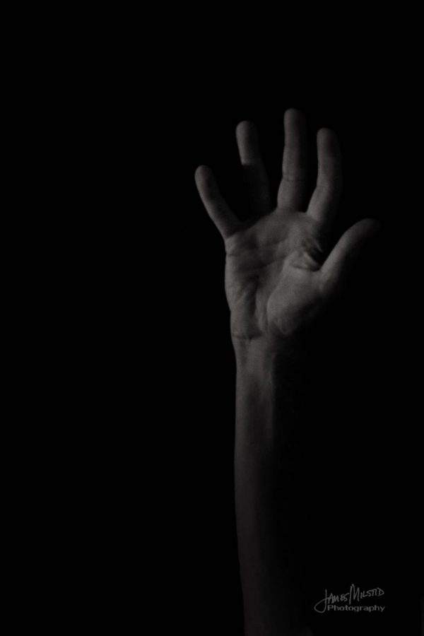 Hand reaching for someone to pull them out of the darkness on October 9, 2018. Mental health is a real thing that affects many. https://www.flickr.com/photos/jamesmilstid/451578827 Photo credit: James Milstid
