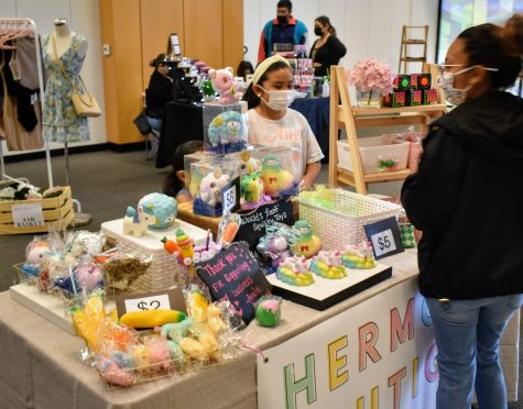 """Analia Perez, 9, sells fidget toys during a small business pop-up event in Norwalk Town Square on May 15, 2021. Her business is called """"Hermosa Boutique by Analia."""""""