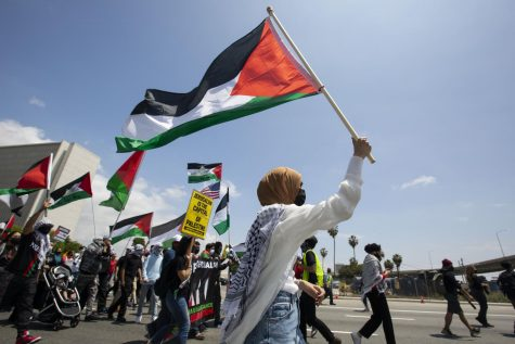 Tension between Israel and the Palestinians increased last week sparking worldwide outrage. People at a Palestinian Rally/Protest on May 15 in Los Angeles demand Palestine be free from violence and oppression.