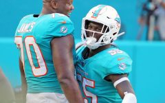 Miami Dolphins' Ja'Wuan James (70) celebrates with Jerome Baker (55) after Baker's interception to help seal their victory over the New York Jets on Sunday, Nov. 4, 2018 at Hard Rock Stadium in Miami Gardens, Fla. Photo credit:  Charles Trainor Jr./Miami Herald/TNS