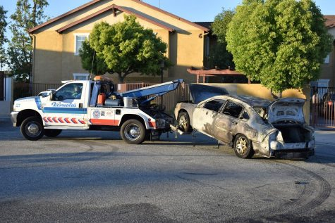 Vernola's Towing Service takes the vehicle to their yard, where it will later be disposed in a junk yard. The Chevy sedan burns after a speaker caught fire in the vehicle's trunk on April 29, 2021.