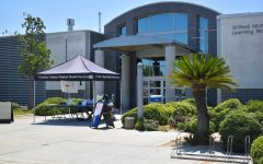 A pre-health screening check-in site is established outside the Cerritos College library on August 9, 2021. They ensure that students have no symptoms of COVID-19 and did not come into contact with people who have the virus.
