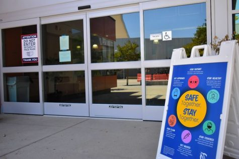 Signs are placed outside Cerritos College buildings and facilities on August 9, 2021. They remind students to wear a mask and follow health and safety guidelines.