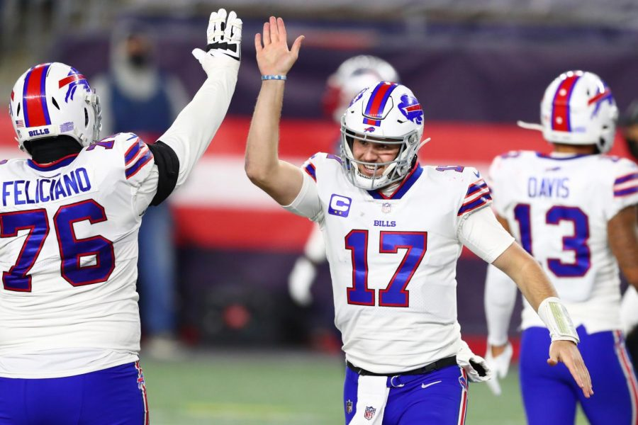 The Buffalo Bills' Josh Allen (17) and Jon Feliciano (76) celebrate during the second half of a 38-9 win against the New England Patriots at Gillette Stadium in Foxborough, Massachusetts, on December 28, 2020. (Adam Glanzman/Getty Images/TNS)